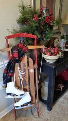 Vintage sleigh with scarf and skates is a fun way to decorate for Christmas.