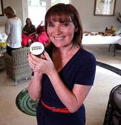 H4H Patron, Lorraine Kelly with a Bake for Heroes cupcake.