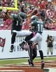 Best of NFL Week 6  --  Foles throws for 3 TDs to lead Eagles past Bucs -- Philadelphia Eagles wide receiver Riley Cooper (14) celebrates with teammate wide receiver DeSean Jackson (10) after scoring on a 47-yard touchdown reception against the Tampa Bay Buccaneers during the third quarter of an NFL football game Sunday, Oct. 13, 2013, in Tampa, Fla. (AP Photo/Steve Nesius)