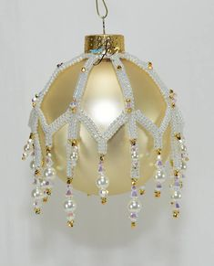 """New for 2017! Weave seed bead Ribbons of herringbone and embellish with lots of Icy Swarovski crystals and pearls to create a beautiful Victorian style ornament cover. The open bottom allows for changing/replacing the glass ornament bulb. Materials Japanese seed bead size 15 ̊ Japanese seed bead size 11 ̊ Tru2 Fire-polished rounds 3mm Bicones 4mm Bicones 4mm Pearls 6mm Pearls 2½"""" diameter Round Ornament Tools Beading Needles size 10 or 11 Nylon beading thread – One-G or Fireline 6 lb ..."""