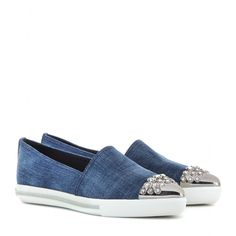 Miu Miu - Denim slip-on sneakers - The slip-on sneaker has fast overtaken the ballerina as the flat of choice. Dressed in blue denim, Miu Miu's plush pair is finished with a crystal-embellished metallic silver toecap, perfect for adding a modern twist to a miniskirt. seen @ www.mytheresa.com