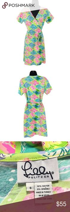 Lilly Pulitzer Wrap Dress Patchwork Lion Hippo Lilly Pulitzer Small Wrap Dress Lion Hippo Crab Fish Patchwork Multicolored Cotton Blend.  In great condition just has a small red dot stain at the front. Please check out all the pictures. Measurements laying flat: shoulder to shoulder: 15 inches.  Pit: 18 inches. Waist: 16 inches. Hip: 20 inches. Length: 36.5 inches. Sleeve: 6 inches Lilly Pulitzer Dresses