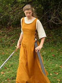 This is a dress that I designed and sewed awhile ago. It is one of the costumes for the movie we are filming. It is basically copied ...