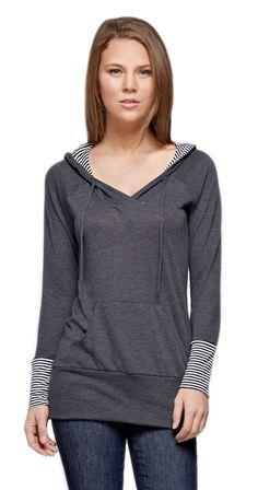 With the cool weather rolling in this hoodie tunic is the perfect top to keep you warm and stylish. Not overly bulky, its a great weight for layering without overheating. The contrast fabric on the wrists and lining keep it visually interesting, and the longer length is awesome for avoiding the dreaded back draft. An awesome choice for hanging out, or working out, this top is a must have for your fall wardrobe.  Solid hoodie Cuffs are meant to fold up to make it a 3/4 length sleeve