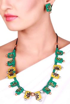 Green Terracotta necklace set Dimension of necklace: 8 inches Dimension of earrings: 1 inches Weight: 56 gms Color: Green Closure: Necklace: String, Earring: Metallic lock Material: Terracotta clay Finish: Hand-crafted Inspiration: Elements Of Nature