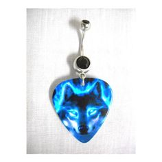 Gorgeous Wildlife WOLF HEAD with Neon Blue Flame Eyes Printed Guitar... ($6.99) ❤ liked on Polyvore featuring jewelry, stone jewelry, animal jewelry, guitar pick jewelry, belly rings jewelry and black jewelry