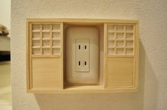Tori Sugimura, a shoji screen designer who says he was inspired by this image of a door-covered electrical outlet, decided to put a Japanese spin on the concept.