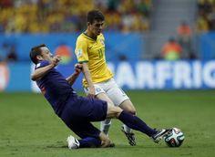 Stefan de Vrij of the Netherlands fights for the ball with Brazil's Oscar. REUTERS/Ueslei Marcelino