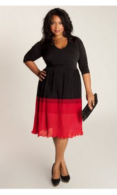 IGIGI by Yuliya Raquel Bardot Plus Size Dress In Black & Red £88.50  Ok so I know again, this is not cheap, but IGIGI are one of the few brands that really seem to understand how to flatter different body shapes without going for the boring old black wrap dress. This one has the all important colour blocking, 3/4 length sleeves and is fully lined so no problems with the skirt sticking to your tights/leggings