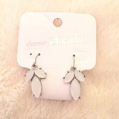 ⚡️FLASH SALE⚡️NWT Charming Charlie White Earrings NWT Charming Charlie white and silver dangle/drop earrings. it came with a matching necklace but the earrings aren't my style Charming Charlie Jewelry Earrings