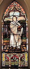 A stained glass portrayal of Martin Luther