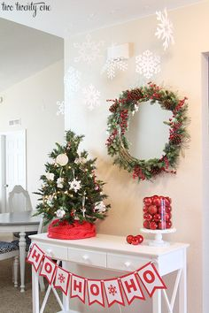Entryway table decorated for Christmas