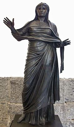 Bronze statue of Livia. She stands, over-lifesize, draped with her hands upraised, perhaps in prayer. Roman Sculpture, Bronze Sculpture, Ancient Rome, Ancient History, Emperor Augustus, Ruined City, Pompeii And Herculaneum, Roman Art, The Empress