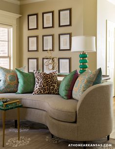 """At Home in Arkansas   January/February 2015   Elements of Style   In the living room, the curved """"Lauren"""" sofa offers comfortable seating that encourages togetherness and conversation. Framed letters from the Civil War era hang in a gallery formation in the background.   @nancynolan @emporiumhome"""