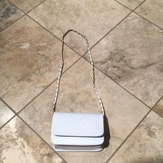 White purse Brand New white small purse with gold chain. Na Bags