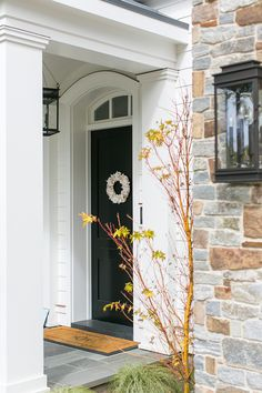 Front Entry. A personalized door mat and a coastal-inspired wreath add some extra charm to the front entry. Front Entry Ideas #Entry #decor #frontentry Brandon Architects, Inc. Churchill Design. Legacy CDM Inc.