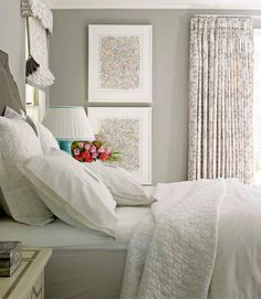Lindsey Coral Harper - Stunning gray monochromatic bedroom design with a pop of turquoise blue. Gray walls paint color, charcoal gray velvet headboard, soft white bedding, white & gray window panels curtains, turquoise blue lamp and vertical artwork.    Farrow & Ball Drag Paper