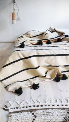 moroccan black + cream stripe blanket with pom pom trim! gimme.