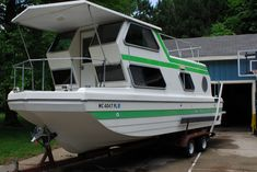 1976 Steury House Boat- restored. (went on one much like this as a child and not green)!