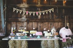 Love is Sweet wedding dessert bar with a paper maché pig card holder | photo by Jessica Oh Photography
