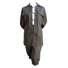 very rare YVES SAINT LAURENT khaki safari suit | From a collection of rare vintage suits, outfits and ensembles offered for sale by JENNIFER KOBRIN VINTAGE at: https://www.1stdibs.com/fashion/clothing/suits-outfits-ensembles/
