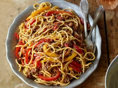 Spaghetti Alla Chitarra With Lamb and Sweet Pepper Ragù: Barely cooked bell peppers add a pop of sweetness to light lamb ragù in a dish from Abruzzo, Italy.