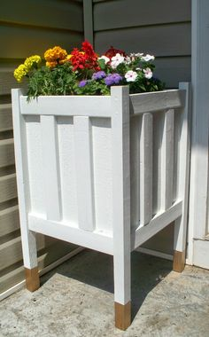 From Anna at 'Home, Heart and Hands', make this DIY porch planter with gold dipped legs, for $8! Yep. Eight dollars. This could be used to dress up any of your outdoor spaces, and it's a pretty simple project.Patios, porches and decks-5-1