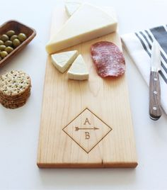 Our personalized cheese boards, like our cutting boards, are made from multiple strips of premium wood that are edge glued and sanded for lasting strength and beauty. Not only are our home goods functional kitchen tools but they are the perfect heartfelt gift to commemorate any occasion. SHOWN IN MAPLE  Interested in a gift set? Message us with your request! HOW TO ORDER: PLEASE FOLLOW THESE STEPS AND INCLUDE THE INFORMATION IN THE NOTES TO SugarTreeGallery SECTION OF THE ORDER: 1. Select…