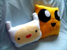 Finn and Jake pillows Austin would putt that on his bed