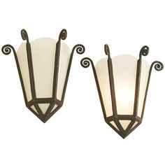 French Art Deco Wrought Iron/Frosted Glass Panel Wall Sconces | From a unique collection of antique and modern wall lights and sconces at http://www.1stdibs.com/furniture/lighting/sconces-wall-lights/