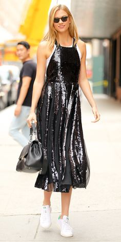 Karlie Kloss schooled us on how to pull off sequins during the day when she grounded a black sequined Tibi evening dress with a white tank underneath, a black tote, and Adidas Stan Smiths.