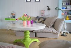 Fun coffee table and bright DIY vases. Comfy, slouchy couch. <3