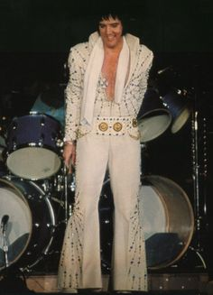 BLUE STARS & GOLDEN COINS! ELVIS wearing the BLUE TARGET aka BLUE STARBURST jumpsuit. THE KING first wore this suit in Vegas for the August-September 1973 stand. He wore it again several times during his 1974 January/February Las Vegas engagement, as well as during the famous 1974 March Tour.  Always with the original Coins belt. Today the suit can be admired on display at Graceland.
