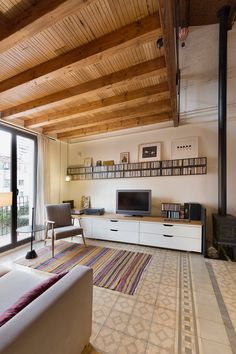 """The mezzanine, where the master bedroom is, was made with reclaimed wood from an old """"Masia"""" (a rural house from Catalunya, Spain)."""