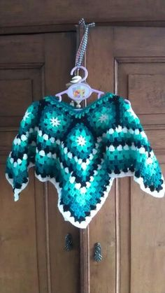 Granny square poncho for a two year old girl. Start with 8 granny squares. Connect them. Than crochet around untill you reach the lenght required