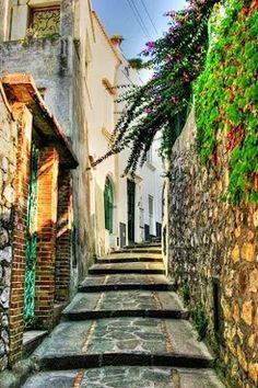 Capri, Italy. Walking up those steps with cute platform sandals will really work those legs!