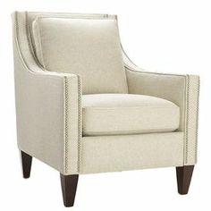 "This nailhead-trimmed arm chair brings relaxed elegance with its swoop-arm silhouette and refreshing neutral upholstery. Handmade in the USA.     Product: ChairConstruction Material: Wood and fabricColor: BarleyFeatures: Nailhead trimMade in the USADimensions: 36"" H x 35.5"" W x 29.5"" D"