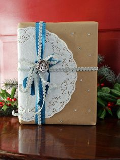What are the holidays without a little sparkle? Top Kraft-paper-wrapped gifts with a glittered paper doily, self-adhesive rhinestones, metallic rick-rack and a glittering mini pinecone.  http://www.hgtv.com/handmade/25-creative-gift-wrap-ideas/pictures/page-11.html?soc=pinterest
