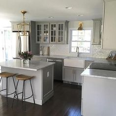 Small Gray Kitchen with Mini Subway Tiles That Go Halfway Up The Wall