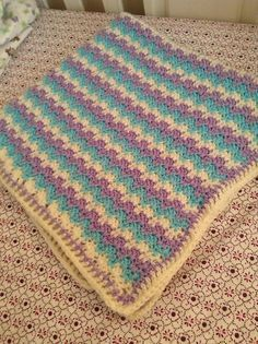 Ravelry: Leaping Stripes and Blocks Blanket pattern by Tamara Kelly