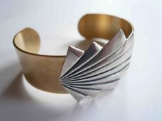 Mixed metal cuff bracelet. Silver and gold art deco cuff. Gatsby era style. Gold cuff with brushed silver geometric fan. by minusOne on Etsy https://www.etsy.com/listing/127406894/mixed-metal-cuff-bracelet-silver-and