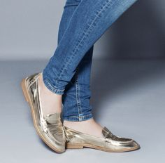 {shiny gold loafers} these must be mine