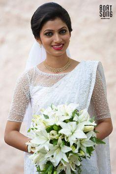 ideas for flowers white wedding groomsmen White Saree Wedding, Kerala Wedding Saree, Kerala Bride, Wedding Sarees, Bridal Sarees, Kerala Saree, Tamil Wedding, Christian Wedding Dress, Christian Bridal Saree