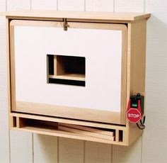 Router cabinet stowed away on a wall