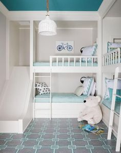 Aqua blue shared girl and boys bedroom features two sets of built-in bunk beds dressed in aqua bedding and pillows illuminated by black and white wall sconces. Bunk Beds Small Room, Bunk Rooms, Kids Bunk Beds, Small Room Bedroom, Trendy Bedroom, Small Rooms, Bedroom Ideas, Bedroom Hacks, Blue Bedroom