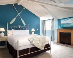 Blue and white nautical bedroom with crossed oars above headboard: http://www.completely-coastal.com/2012/11/coastal-beach-villa-at-pacific-edge.html
