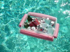 Floating beverage center made with a pool noodle and a plastic bin.