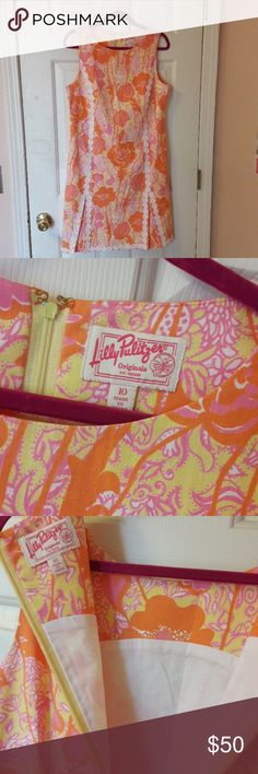 Lilly Originals Hen House Shift Gorgeous Lilly Pulitzer Shift Originals in: Starfruit Yellow Hen House Pink Lace Dress. Absolutely perfect condition! Like new! Very classic. Pleated on front.  Very well made!! Size 10 Only worn once for family pictures! (My sister has the other dress for sale too. If interested in that one comment below) Lilly Pulitzer Dresses