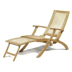Kaare Klint A LOUNGER oak, cane, brass fittings, with folding action and original detachable cushion and head rest, the hinged footrest sliding under seat when not in use 88cm.; 2ft 10½in. designed 1933