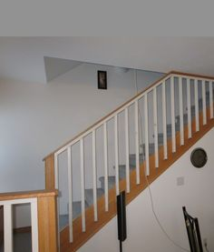 7. Compositional Principles + Elements: Again, the stair treads and spindles create patterns and shapes. The white space shapes of the walls are defined by tonal qualities of the color. They contrast with the busy patterns of the treads and spindles. There is an asymmetrical balance of visual elements here.